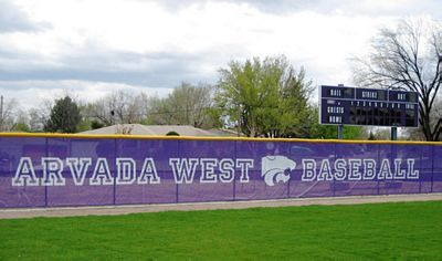 Another benefit of a fence covering is the ability to advertise. This bright purple screen doesn't provide a whole lot of protection, but it does advertise the school it belongs to.