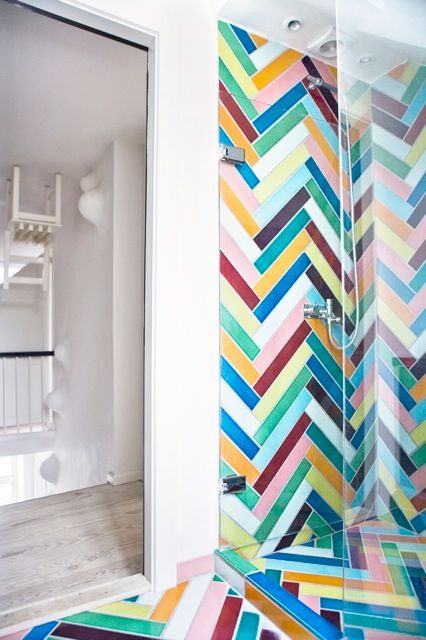 This is wacky and I love it. Amazing colourful herringbone tile pattern in this bathroom. The effect is very invigorating; it could also be beautiful and peaceful in a monochrome or analogous color scheme.