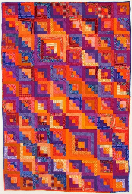 Orange explains it all: log cabin quilt in orange and purple: