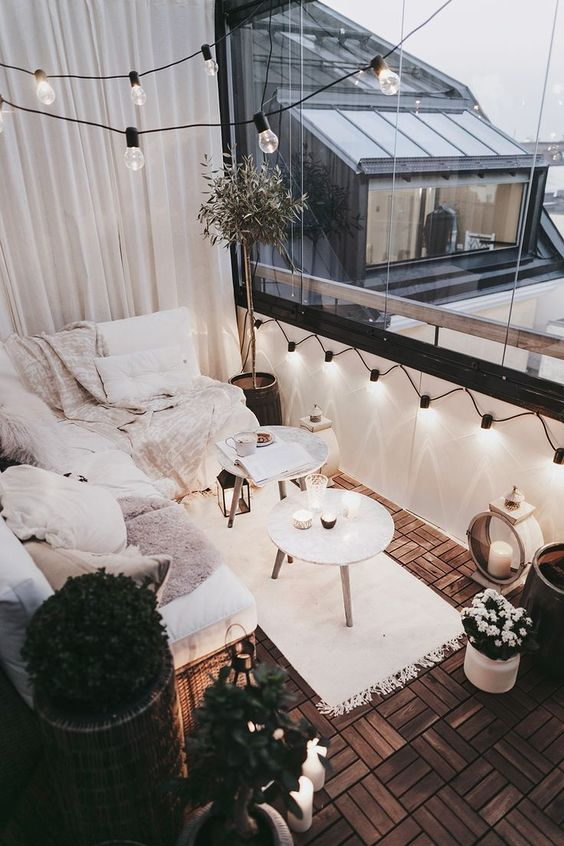 All White Cozy Patio Ideas String Bulb Lights | The Best Decorated Small Outdoor Balconies on Pinterest | Small Patio Decor Ideas | Boho Apartment Patio Inspiration | Outdoor Furniture Inspiration