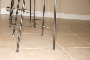 Can you lay stick and peel vinyl tiles over linoleum vinyls tile