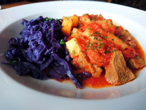 A pork and chorizo stew made with Old Cannon ale and a side of braised red cabbage at The Old Cannon Brewery. William Howard/Stars and Stripes