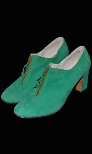 1960s green suede shoes with zippers and tassles from designer Robert Evans. Sole reads Exclusively Robert Evans in Las Vegas Lake Tahoe - Lady Doll Last.