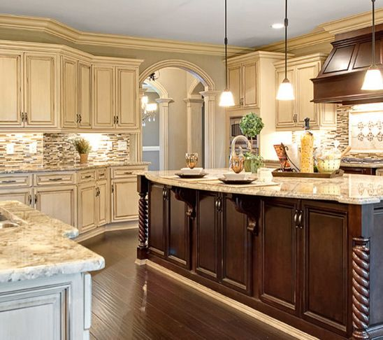 Kitchen Cabinets And Islands french cream antiqued painted wood cabinetry featuring espresso