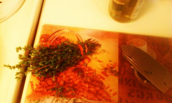Getting the fresh thyme ready.  (Apple Cider Chicken)