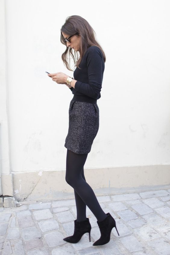 Long sleeves, tweed skirt, opaque tights, heels. Add a blazer if it feels too out-on-the-town. [Photo by Kuba Dabrowski]