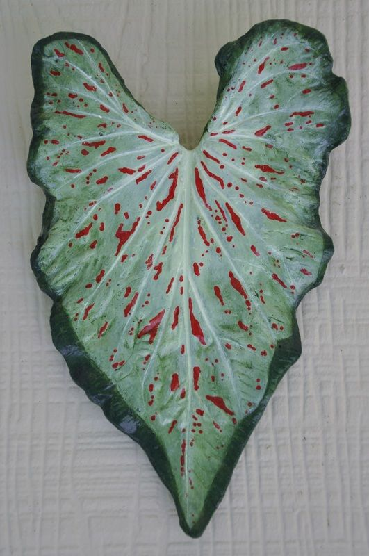Sandcast cement wall art, created from a real leaf. Handpainted.