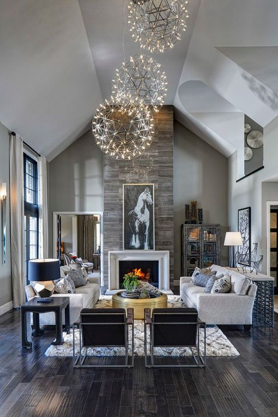 Living room, great room, dark rustic wood floors, stone fireplace, orb chandeliers, horse art | Moceri Homes: