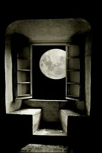 Moon in rustic window