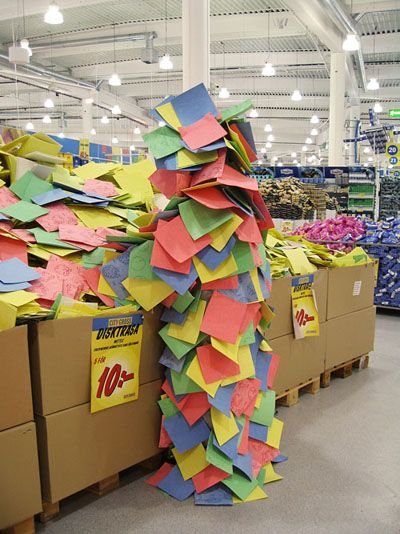 An Urban Camouflage performance took place in 2007 at a Stockholm IKEA where people roamed the store wearing costumes made out of papers, boxes and bags.