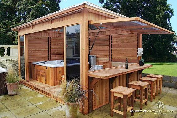 With this enclosure you can keep all the walls closed and you've got a warm area to enjoy your tub. You can also open them up and you've got windows to the outdoors, a large doorway and even a bar where everyone can sit and have a couple drinks.