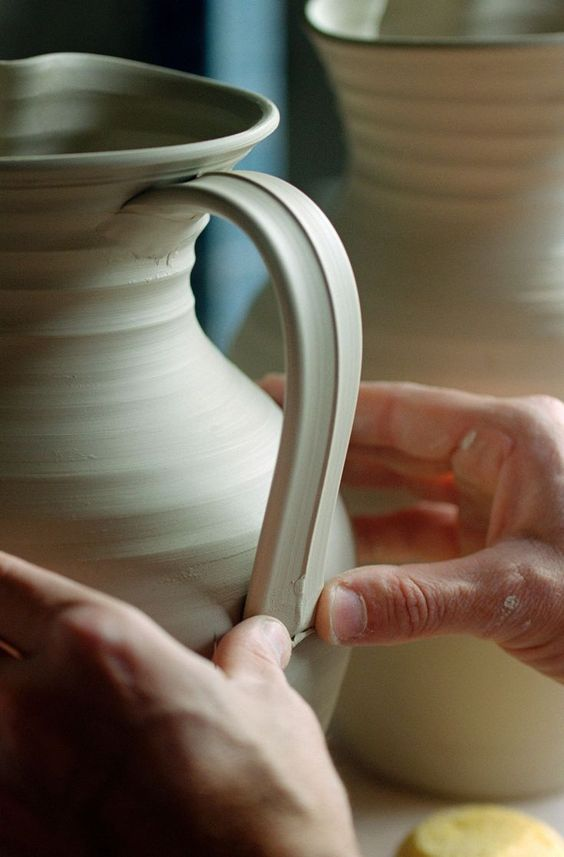 Learn how to pull a handle and attach it to your pottery projects in this step-by-step instructional guide.