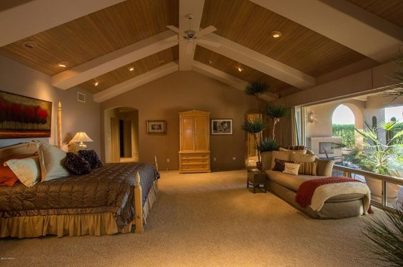 Mediterranean Master Bedroom with Angel Line - Mary Armoire, Carpet, Shaw Floors Confident Smile Carpet, Ceiling fan