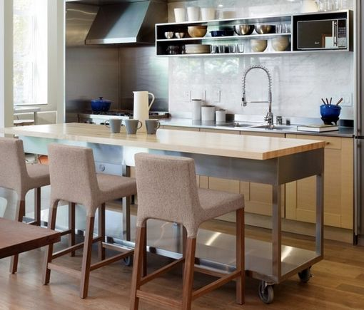 This Darktoned Wooden Kitchen Island Features A Wine Rack Beside Unique Kitchen Island On Casters Review