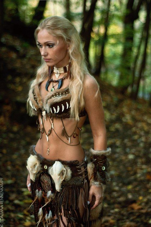 She certainly not defending anything, most warriors don't wear fur bras with their stomach exposed. More like, Amazon by Mattel?