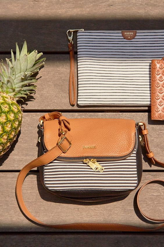 Summer stripes and neutrals that go with everything. Clutches, wristlets, crossbodys and more.