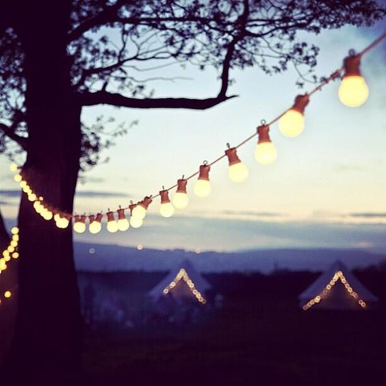 Glamping in Yorkshire. Fairy lit bell tents and festoon lighting.
