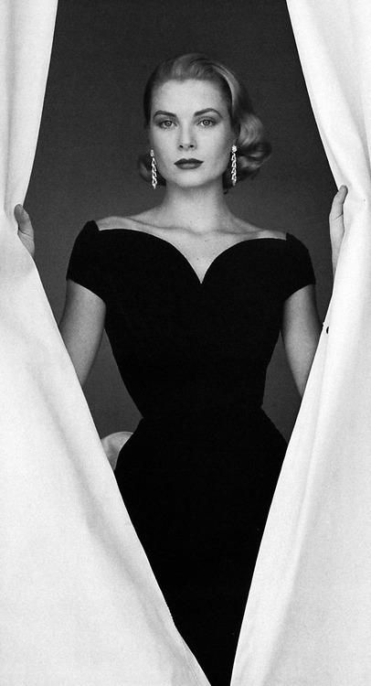 Grace Kelly perfectly accentuates her little black dress with a pair of statement earrings. Her look is refined, understated, and dignified- this is how to do style, ladies. #SAFWstyle