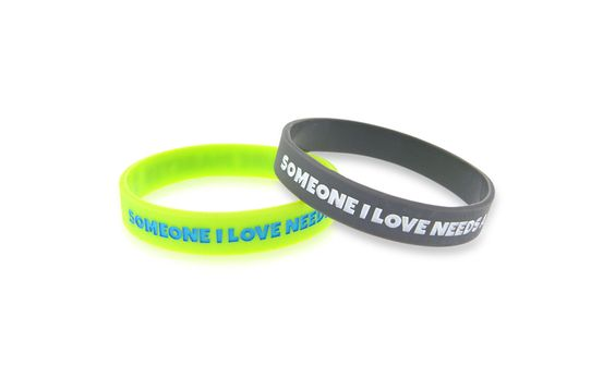 "Someone I Love Needs a Cure - Cure Diabetes' Awareness Bracelet Our new diabetes awareness bracelet is a great way to show support for your loved ones. This band features the message ""Someone I Love Needs a Cure. Cure Diabetes"" in bold lettering. It's a simple way to share your hope for a cure!   $1.00"
