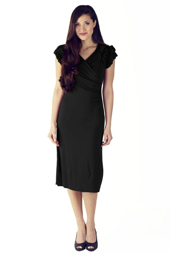 Modest Dresses in Black: The Rebecca dress is simply stunning. It's the perfect LBD! The detailed gathered and ruffled sleeves and high cross-over v-neckline add to it's charisma. This style also features slight ruching on the sides to help flatter and slim the waist.     Wearing the Rebecca you'll feel chic and polished at any event from casual to formal! $49.99 http://www.jenclothing.com/mi-1205-rebecca-black.html