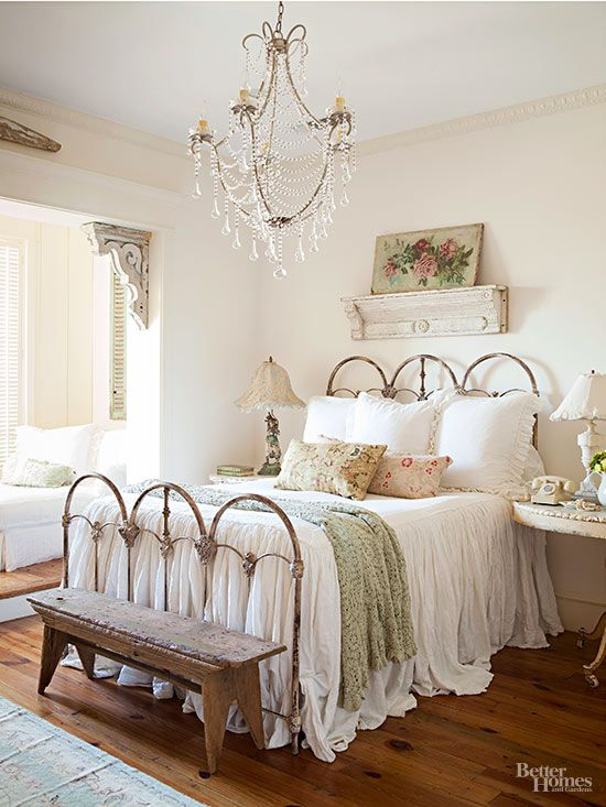 With so many layers of white in this cottage bedroom, texture leaps to the forefront to distinguish each element. Notice that each shade of white differs a little from the others, and intriguing textures -- chipped paint on the corbels and shelf, pocks on the wooden bench, open stitches on the throw, and ruffles and gathers on the linens -- catch the light differently to tantalize the eye./