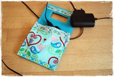 Plug in the charger, hang the bag on the plug and place your iPod or phone inside