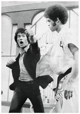 "Jim Kelly and Bruce Lee practicing on the set of ""Enter the Dragon"""