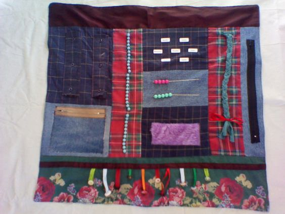 Fidget Quilt for Alzheimer's and Dementia Patients by UrbanFrog, $42.00.  Alzheimer's patients often have very busy hands. They constantly need to be working at something. My mom picks at her head and skin if she doesn't have something to do with her hands. I'm thinking about getting one of these fidget blankets. This is the non-silliest looking best priced one could find. I searched everywhere. Found on Etsy. My mom would not like it if it had dolls and frogs hanging on it like a baby toy!!