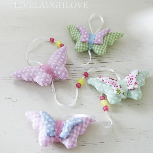 Pretty hanging padded fabric butterfly garland hanging from white satin ribbon…