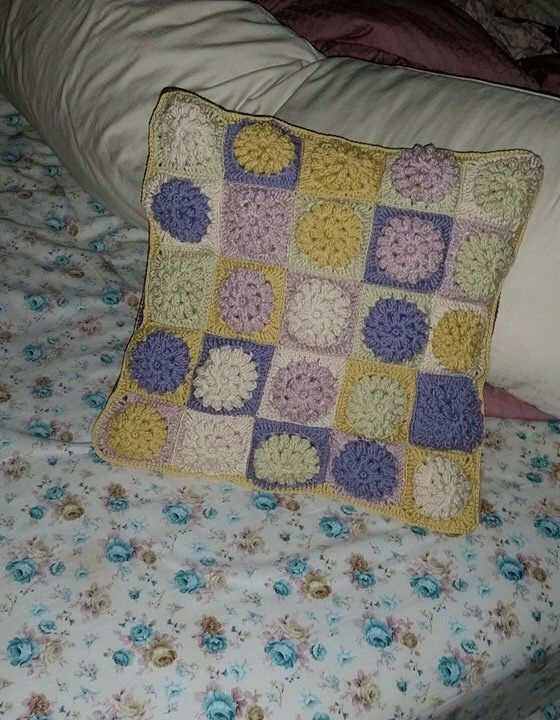 Fluffy granny squares cushion cover.