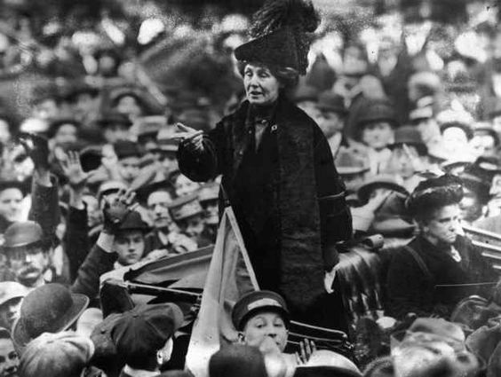 New York, 1911: Emmeline Pankhurst being jeered by a crowd of men.