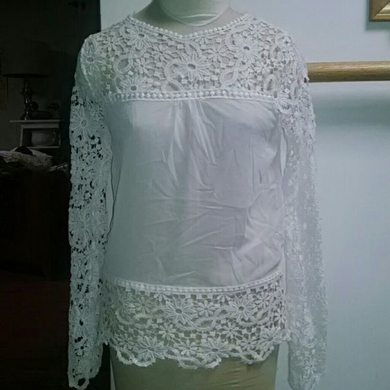 Cutout Crochet White Boho Top by Xizifashion Here's a very pretty blouse by Xizifashion.  Sleeves, bottom hem, and top of the blouse are all cutout/crocheted.  The main fabric is sheer (no fabric content tag).  Never worn.  This shirt is marked XXXL - BUT - that is Asian sizing.  This would probably better fit a small or medium. Xizifashion Tops Blouses