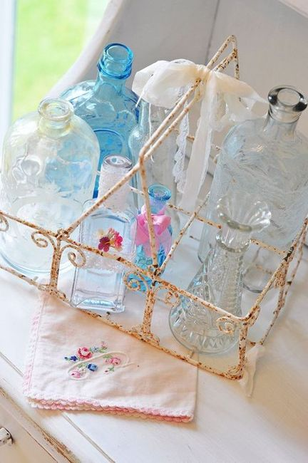 rusty old milk carrier with vintage coloured bottles.......love it