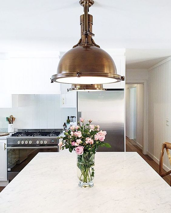 Modern farmhouse farmhouse kitchens and brass pendant on for Farmhouse pendant lighting kitchen