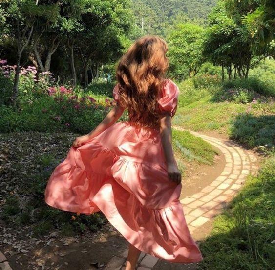 Woman in a dress running