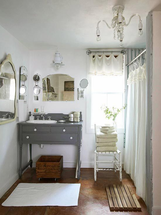 This gorgeous vintage-inspired bath features a vanity made from antique furniture. More low-cost bathroom solutions: http://www.bhg.com/bathroom/remodeling/projects/quick-bathroom-updates/?socsrc=bhgpin070912#page=6