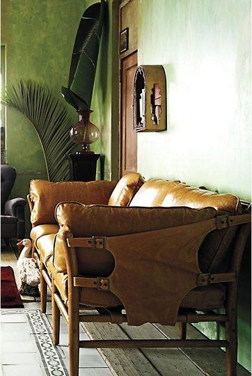 I have no idea where this love for leather furniture is coming from... but man, oh man look at that sofa.