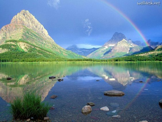 Rainbow over Montana mountains.