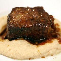 Guinness-Braised Beef Short Ribs, Drunken Prunes, Cipollini Onions, and Root Vegetables Recipe