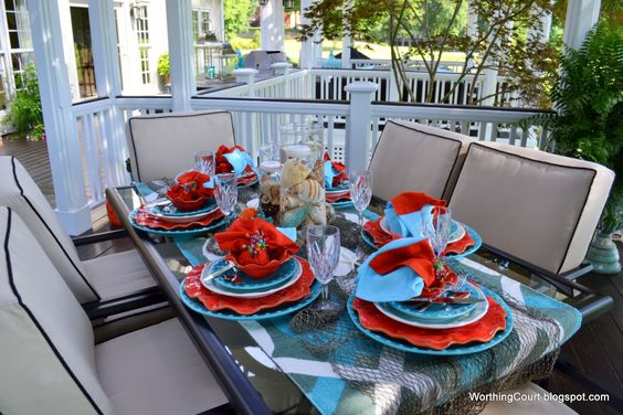 Coral and turquoise table setting.  Love it