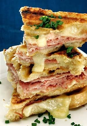 OOZING FLAVOR: A croque-monsieur recipe prepared on a panini grill combines Gruyre cheese and Black Forest ham into a sublimely golden melt.: