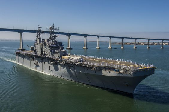 SAN DIEGO,June 17,2014.Amphibious assault ship USS Peleliu (LHA 5) transits San Diego Bay for Rim of Pacific 2014.23 nations,over 40 ships & subs,over 200 aircraft & 25,000 personnel participating in Rim of the Pacific exercise.Rim of the Pacific provides unique training opportunity that helps participants foster & sustain cooperative relationships that are critical to ensuring safety of sea lanes & security on the world's oceans.(USN Mass Comm Spec 2nd Class Kenan O'Connor)