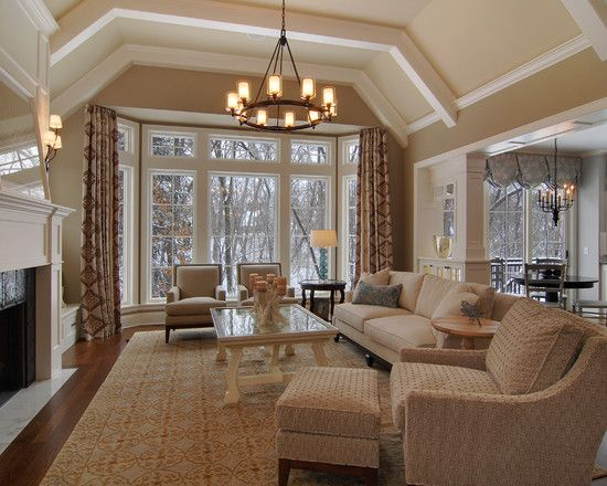 Great Looking Living Room With Beamed Angled Ceiling