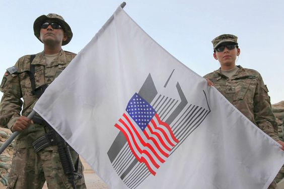 U.S. Army Sgts. Rovin Seosankar, left, and Jennifer Pineda hold a 9/11 commemorative flag on Kandahar Airfield, Afghanistan, Sept. 9, 2014. Seosankar are both assigned to New York Army National Guard's 4th Financial Management Sustainment Detachment. U.S. Army photo by Staff Sgt. Rich Stowell