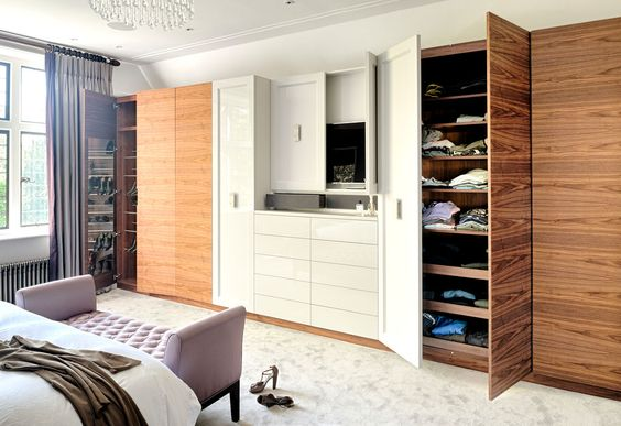 Bespoke wardrobe in wild American Walnut in combination with high gloss white lacquer finish #INTERIOR-iD #London #interiordesign