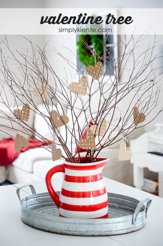 Use branches from your backyard to create the most adorable & simple DIY Valentine tree! Perfect for Valentine decor, and even wedding centerpieces!: