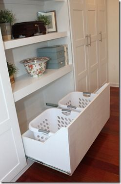 Para la lavandería Add a drawer in a custom closet (this one is an IKEA Pax Wardrobe hack) for storing laundry baskets.  LOVE!