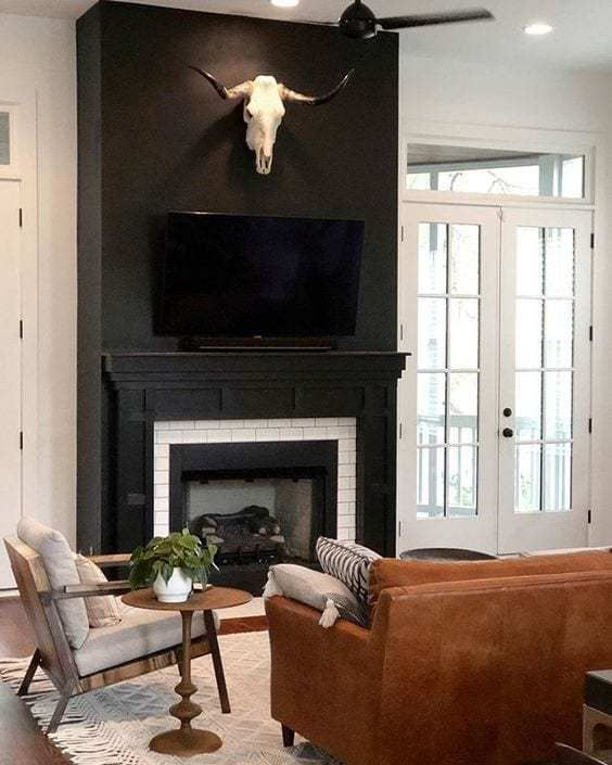 Making A Case For Black Paint Black Living Room Black Fireplace Wall Black Rooms