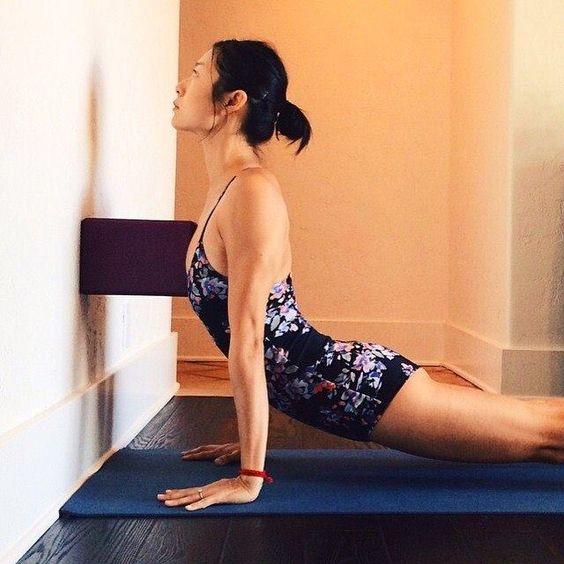 Using a block to lift the sternum and open the chest. Urdhva Mukha Svanasana, upward facing dog. Iyengar Yoga.