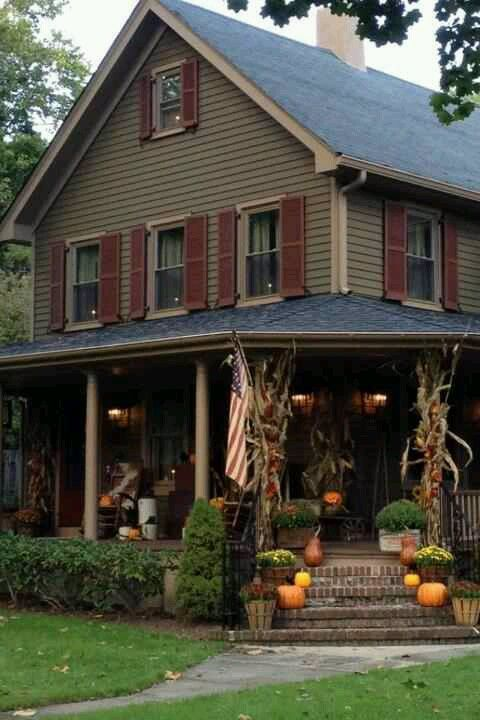 Fall Welcome... Love the colors of the house, the little lights in all the windows and the porch steps with pumpkins.